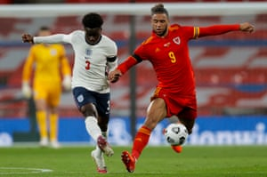 Bukayo Saka of England and Wales's Tyler Roberts vie for the ball.