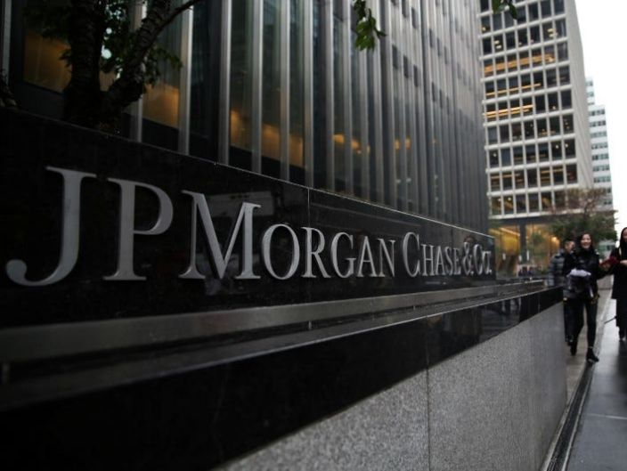 """A sign of JP Morgan Chase Bank is seen in front of their headquarters tower in New York <span class=""""copyright"""">Reuters</span>"""