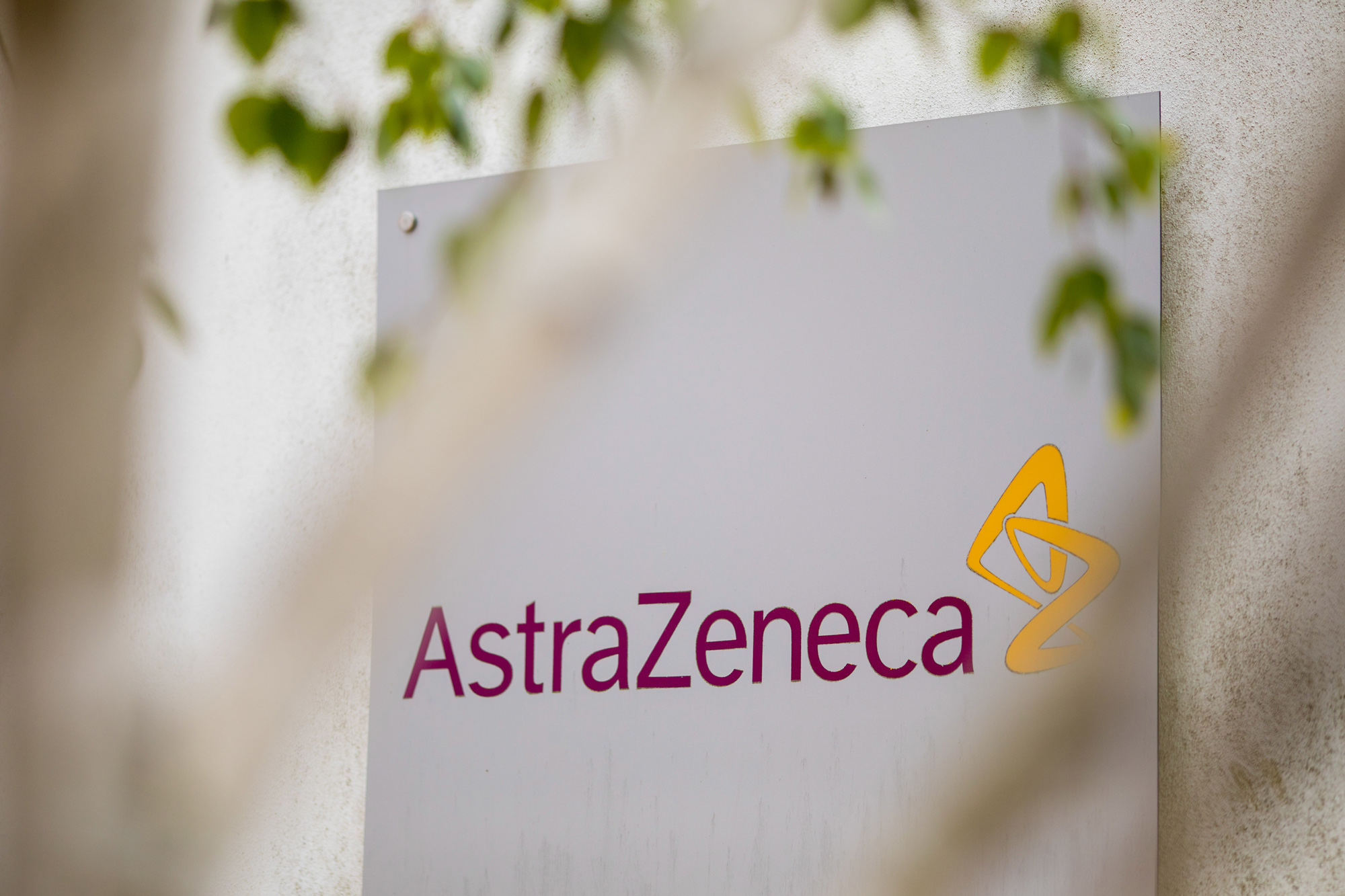 A sign featuring the AstraZeneca logo stands at the company's DaVinci building at the Melbourn Science Park in Cambridge, U.K., on June 8.