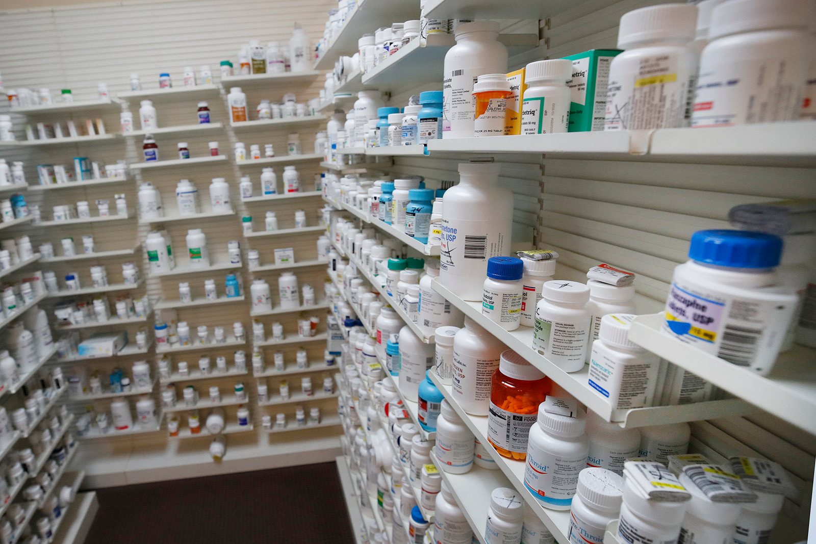 Bottles of pills sit on shelves at Rock Canyon Pharmacy in Provo, Utah, on May 20.