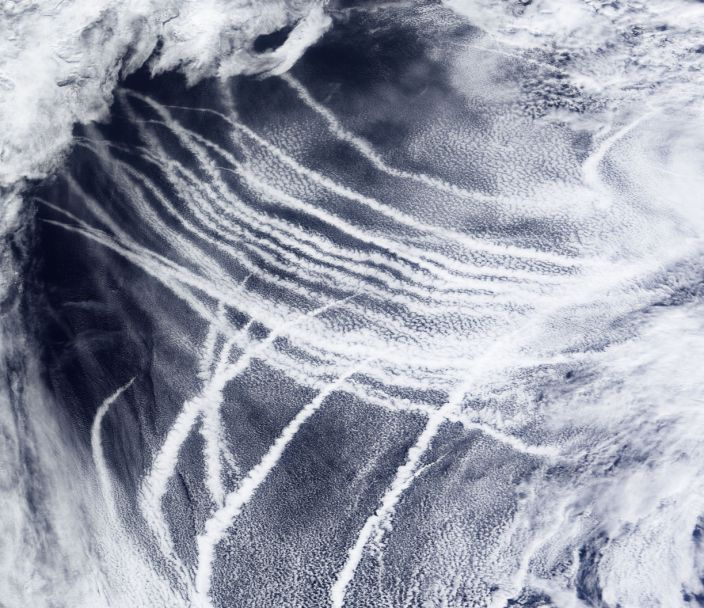 The sky over the northeast Pacific Ocean is streaked with clouds that form around the particles from ship exhaust on March 4, 2009. (NASA Earth Observatory via The New York Times)