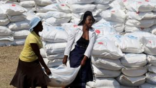 Villagers collect food aid provided by the United Nations World Food Programme (WFP) at a distribution point in Bhayu, Zimbabwe, September 14, 2016.