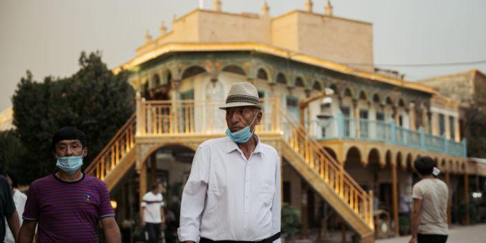 KASHGAR, CHINA - JUNE 30, 2020. An old Uyghur man walks in Kashgar old city on June 30, 2020 in Kashgar, China. (Photo by David Liu/Getty Images)
